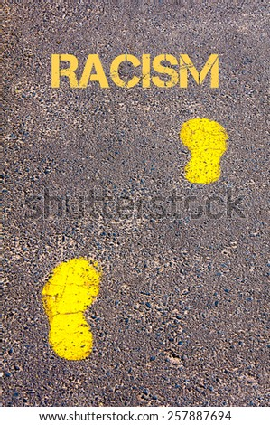Yellow footsteps on sidewalk towards Racism message.Conceptual image