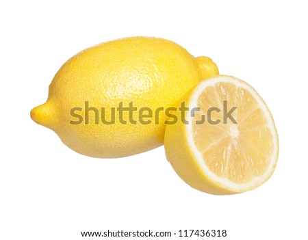 Yellow fresh lemon with a half isolated on a white background - stock photo