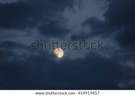 Yellow full moon night with dark clouds