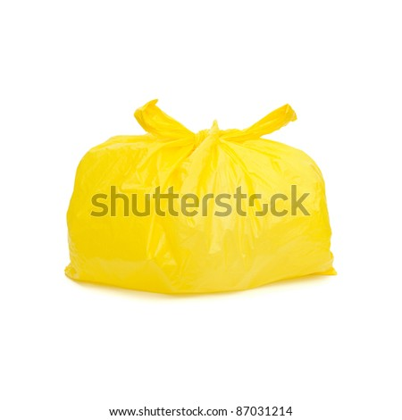 Yellow garbage bag isolated on a white background - stock photo