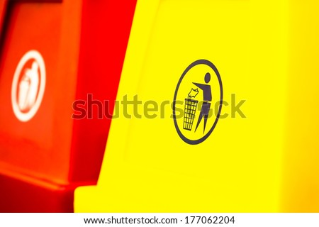 Yellow garbage pail with sign - stock photo