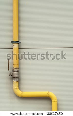 yellow gas pipe with a crane and valve - stock photo