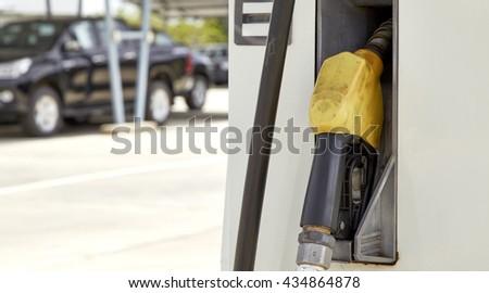 Yellow gas pump, Fuel nozzle pump - stock photo
