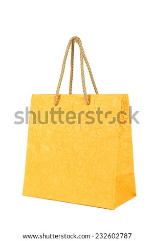 Yellow gift bag isolated on white
