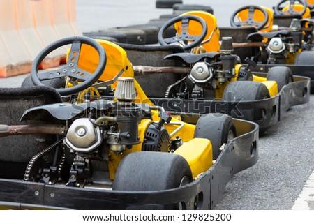 Yellow Go-kart in perspective row - stock photo