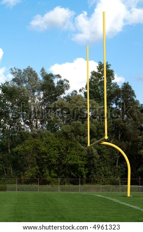 yellow goalposts for an American football game - stock photo