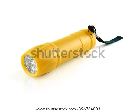 Yellow gold flashlight with LED light on white background