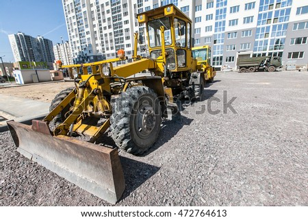 yellow grader on construction site