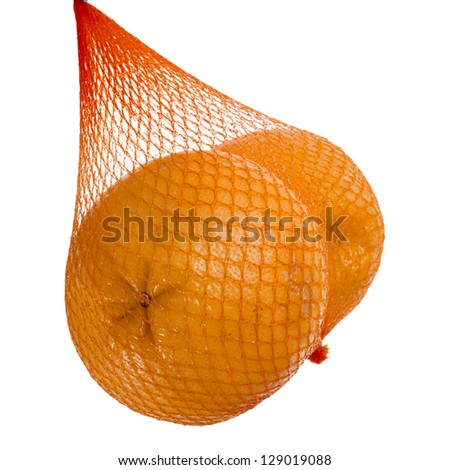 yellow grapefruits hanging  in the mesh bag  isolated on white background - stock photo