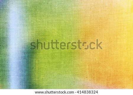 Yellow, green and blue colors applied to canvas texture