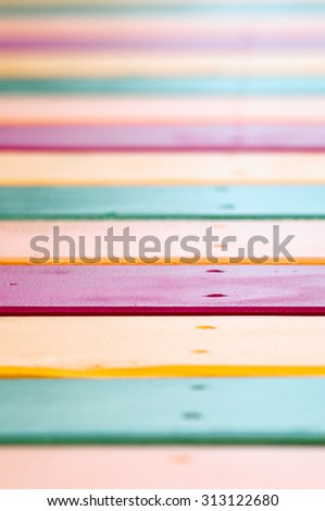 Yellow, green and red painted planks, striped versicolor vivid background