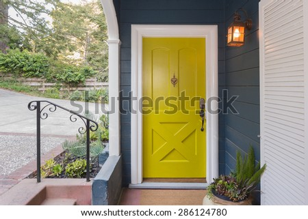 Yellow Green entry door / front door with single cylinder entrance electronic handle-set. - stock photo