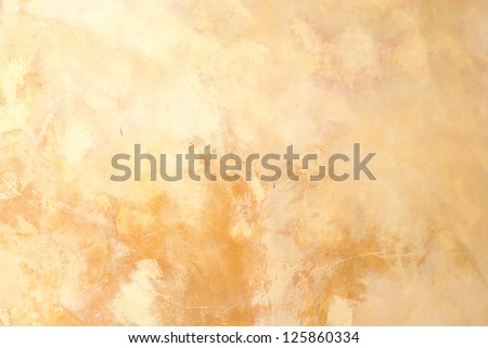 Yellow grunge cement wall background - stock photo