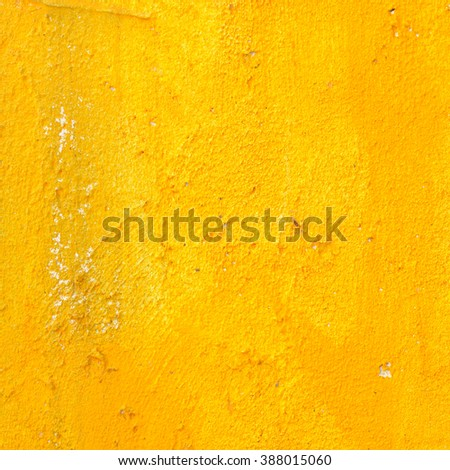 Yellow grunge cement wall for texture background - stock photo