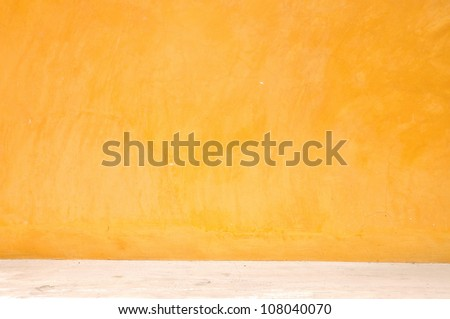 Yellow grunge wall with street, textured background - stock photo