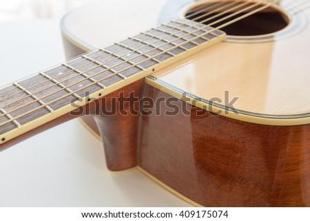 Yellow guitar strings closeup, acoustic guitar close-up detail of musical instruments closeup of acoustic guitar strings. Selective focus - stock photo