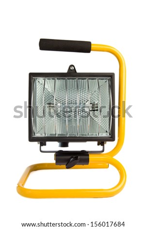 Yellow halogen work light on a stand, isolated on white background