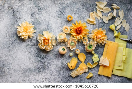 Yellow handmade flowers messy table artist stock photo royalty free yellow handmade flowers messy table of an artist creating paper flowers mightylinksfo