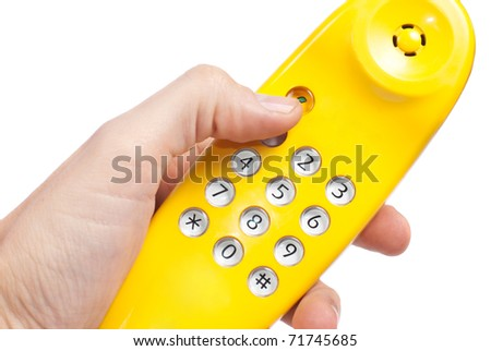 yellow handset in hand, isolated on white