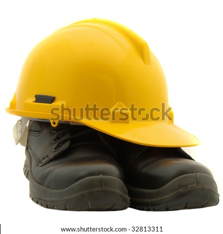 Yellow hard hat and black safety shoes isolated on white - stock photo