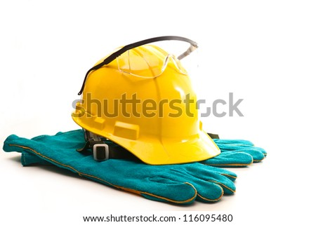 Yellow hard hat and safety glasses for safe operation on a white background - stock photo