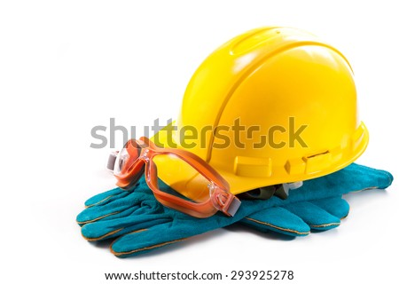 Yellow hardhat, goggles and gloves to work on a white background - stock photo
