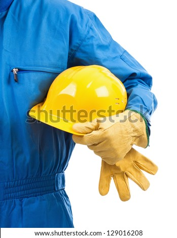 Yellow hardhat under arm against white background - stock photo