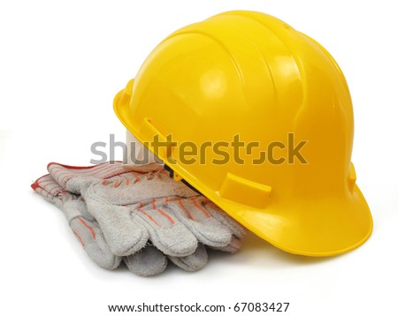 Yellow hardhat with work gloves - stock photo