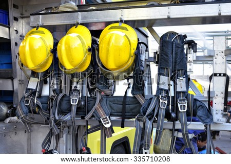 Yellow hat of Fireman ,standby on fire truck. - stock photo
