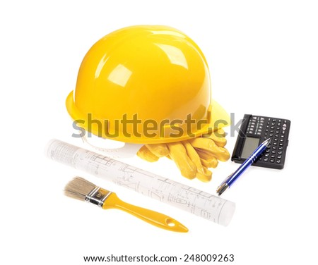 Yellow helmet, brush,calculator and project drawings isolated on white background