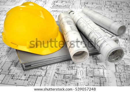 Yellow helmet, grey folder document and project drawings