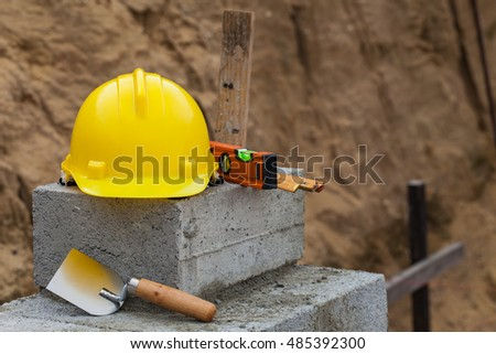 yellow helmet on the building site