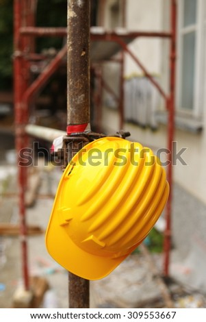 Yellow helmet on work place