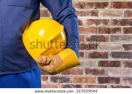 Yellow, helmet, worker. - stock photo