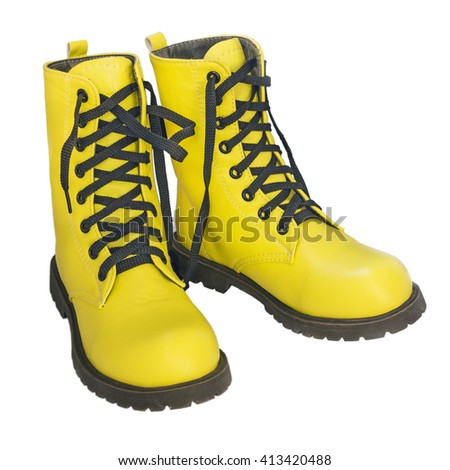 Yellow high shoes with black laces on a white background - stock photo