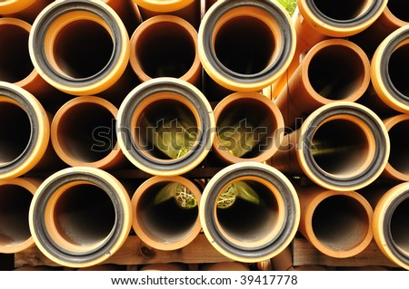yellow hollow pipes - stock photo