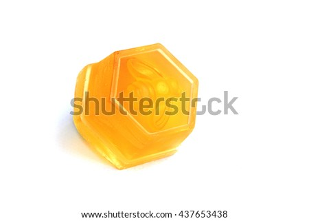 Yellow honey soap as hexagon in white background - stock photo