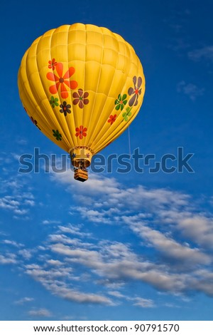 Yellow Hot Air Balloon in Flight