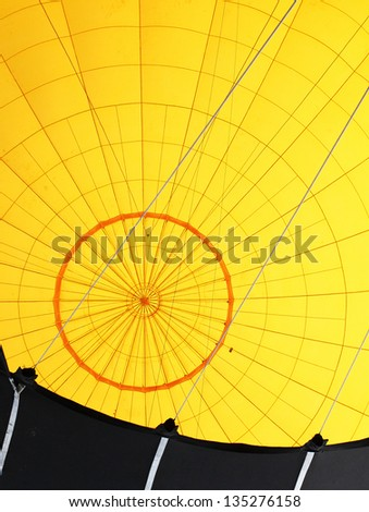 Yellow hot air baloon inside. Retro technology background. - stock photo