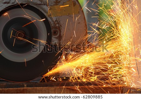 Yellow hot sparks at grinding steel material