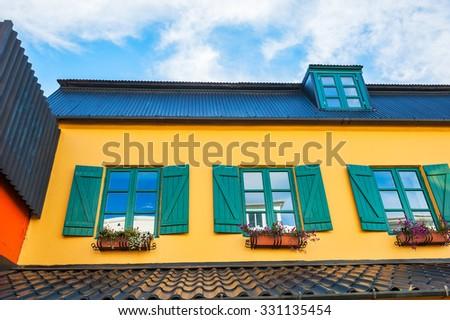 Yellow house with green windows. Reykjavik, Iceland - stock photo