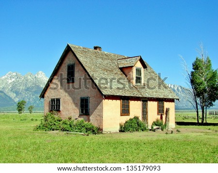 yellow house with mountains