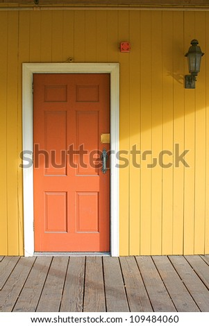 yellow house with red door