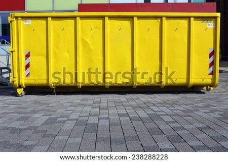 yellow industrial garbage skip - stock photo