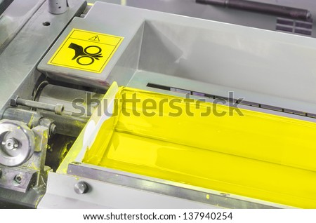 yellow ink roller, printing press industrial machine, hand caution sign for awareness