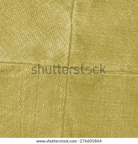 yellow jeans texture,seams in shape of the cross - stock photo