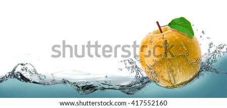 Yellow, juicy apple as a card on the water background. - stock photo