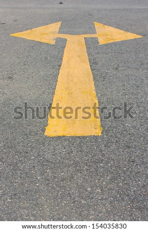 yellow junction arrow on the street