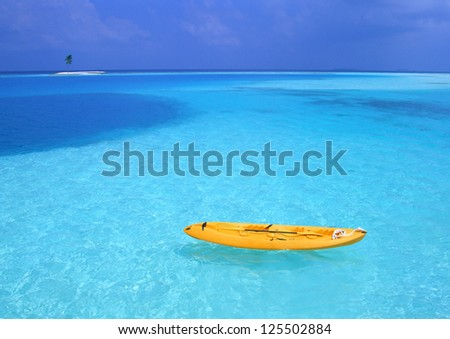 yellow kayak - stock photo