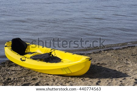 Yellow kayak on the beach.